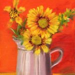 Ceramic pitcher with sunflowers.