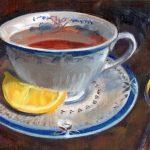 Tea cup with tea and lemon
